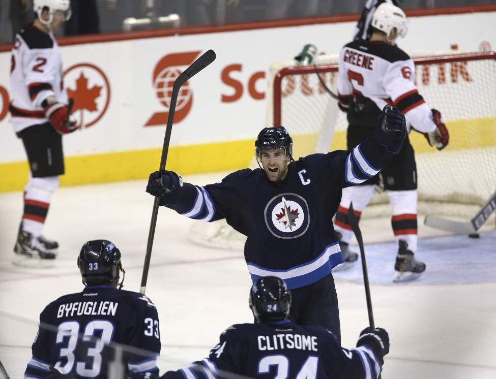 Winnipeg Jets' Andrew Ladd celebrates after scoring what would be the game-winning goal against the New Jersey Devils' at MTS Centre in Winnipeg, Thursday. (Trevor Hagan / Winnipeg Free Press)