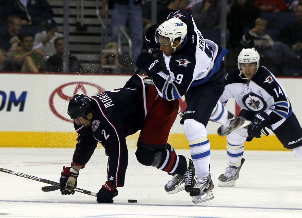 The Winnipeg Jets vs.Columbus Blue Jackets at Nationwide Arena in Columbus, Ohio. First Period action. Jets Evander Kane gets creamed by Blue Jackets #2 Radek Martinek. Sept. 20, 2011 (BORIS MINKEVICH / WINNIPEG FREE PRESS)
