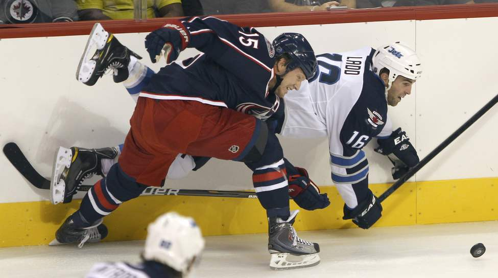 Winnipeg Jets Andrew Ladd, rear, ties it up with Columbus Blue Jackets Derek Dorsett during first period NHL preseason hockey in Winnipeg Tuesday. (JOE BRYKSA / WINNIPEG FREE PRESS)