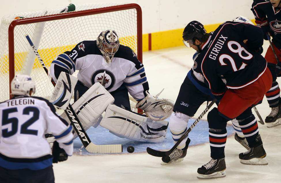 Winnipeg Jets goaltender Ondrej Pavelec stops Columbus Blue Jackets Alexandre Giroux during first period NHL preseason hockey in Winnipeg Tuesday.   (JOE BRYKSA / WINNIPEG FREE PRESS)