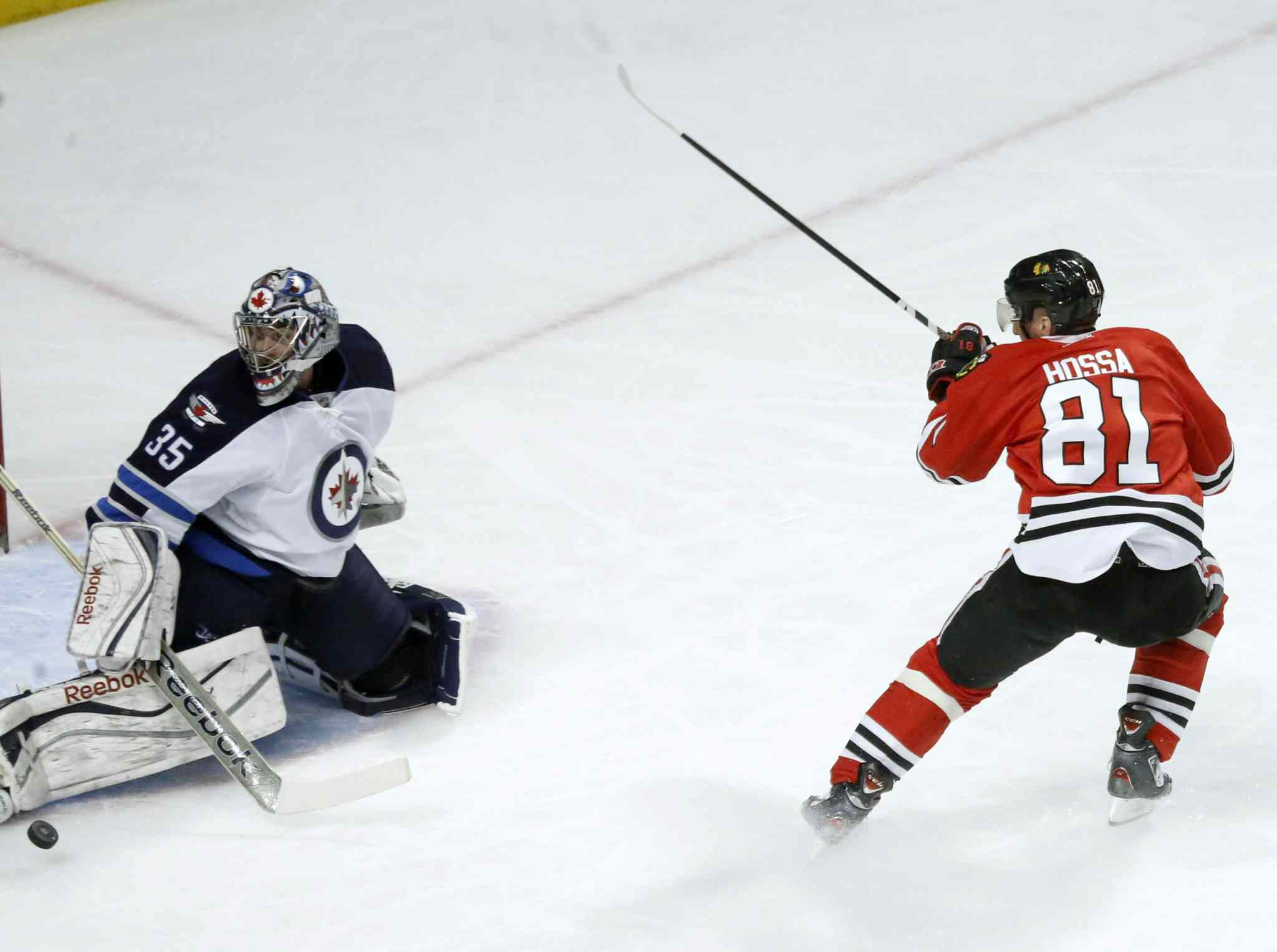 Jets goalie Al Montoya makes a save on a break away by Blackhawks forward Marian Hossa. in Chicago. (AP Photo/Charles Rex Arbogast)
