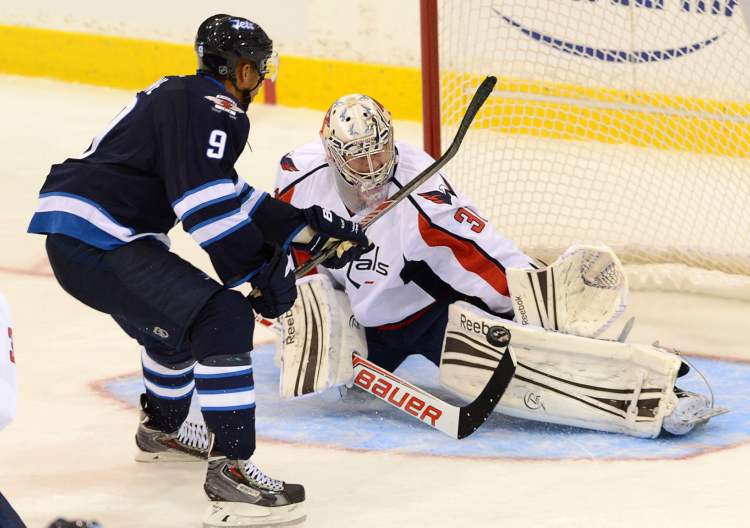 Capitals' goalie Philipp Grubauer stops a break-away shot from Winnipeg Jets' Evander Kane during pre-season NHL hockey action in Belleville, Ont., on Saturday.
