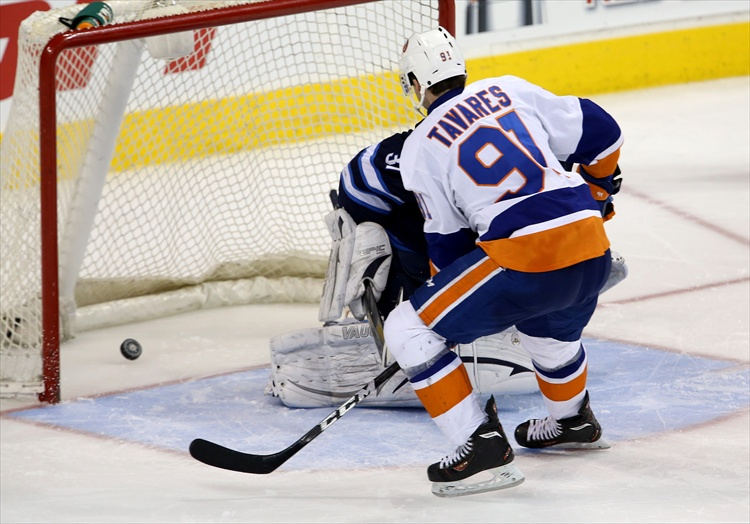 John Tavares puts the game-winning shootout goal past Ondrej Pavelec. (Trevor Hagan / Winnipeg Free Press)