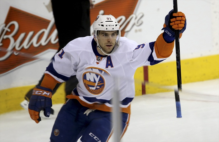John Tavares celebrates his game-winning shootout goal, which gave the Islanders a 5-4 victory over the Jets.