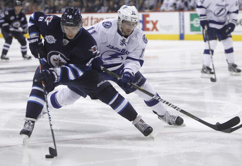 Winnipeg Jets' Alexander Burmistrov (8) and Tampa Bay Lightning's Tom Pyatt (11) battle for the puck during second period NHL action at MTS Centre in Winnipeg, Saturday, April 7, 2012. (TREVOR HAGAN/WINNIPEG FREE PRESS)