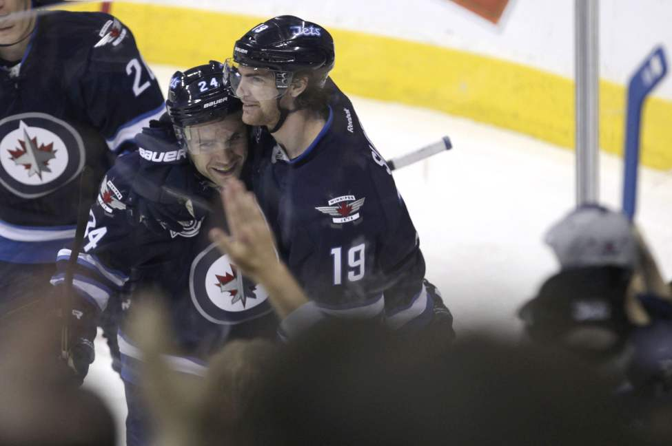 The Winnipeg Jets play the Tampa Bay Lightning in the Jets final game of the season.  Winnipeg Jets' Jim Slater (19) celebrates with Grant Clitsome (24) after scoring a goal in the third period. 120407 - Saturday, April 07, 2012 -  (MIKE DEAL / WINNIPEG FREE PRESS)