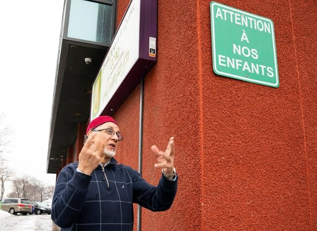 Quebec Islamic cultural centre president Boufeldja Benabdallah walks out of the Islamic Cultural Centre, before reacting to the deadly shooting in New Zealand, Friday, March 15, 2019 in Quebec City. THE CANADIAN PRESS/Jacques Boissinot