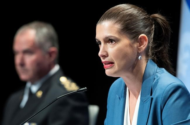 Quebec Deputy Premier and Public Security Minister Genevieve Guilbault during a news conference on the COVID-19 pandemic, Friday, September 18, 2020 in Quebec City. Guilbault announced interventions by police forces across the province. Quebec City police director Robert Pigeon, left, looks on. THE CANADIAN PRESS/Jacques Boissinot