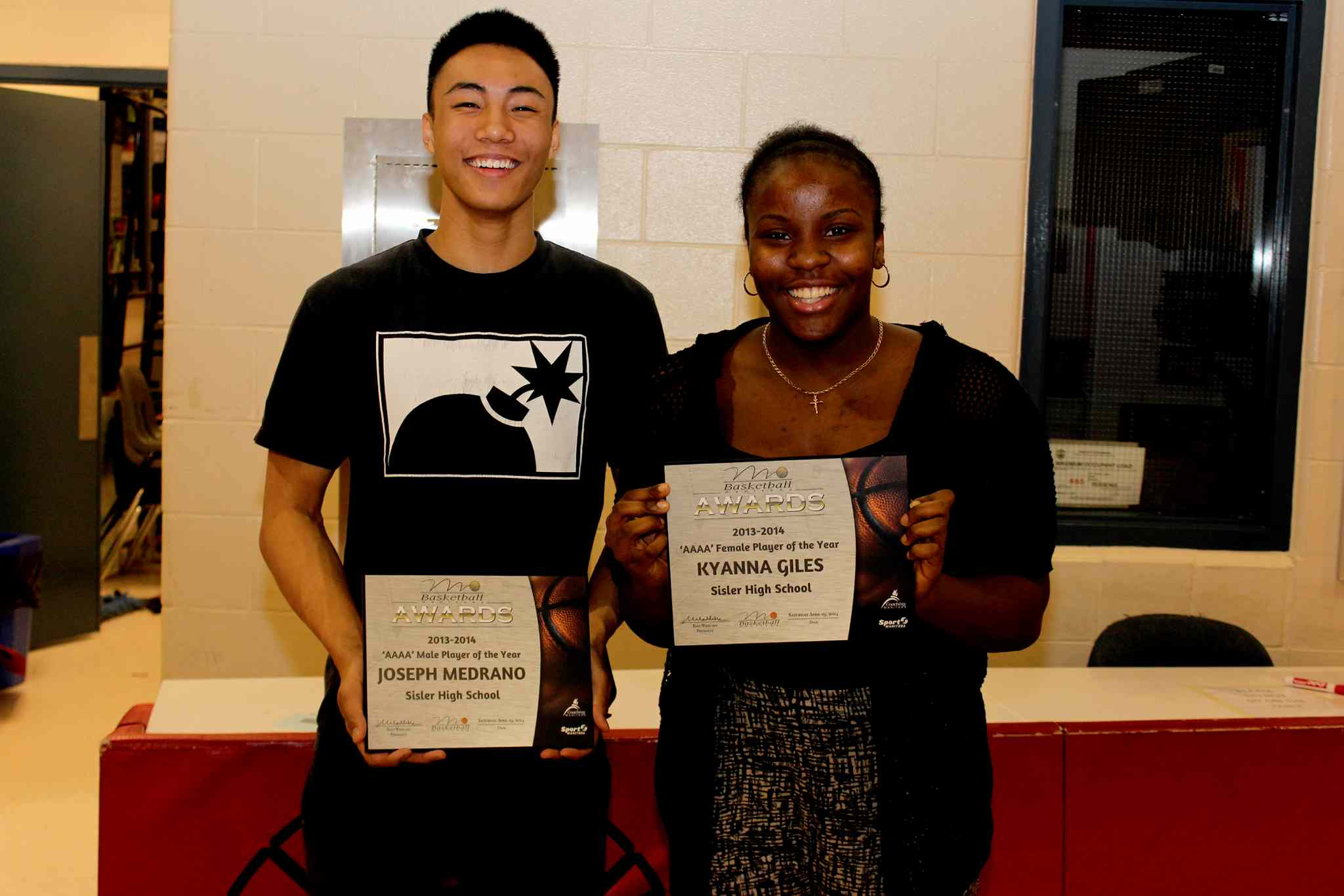 Joseph Medrano and Kyanna Giles were named AAAA players of the year by Basketball Manitoba.