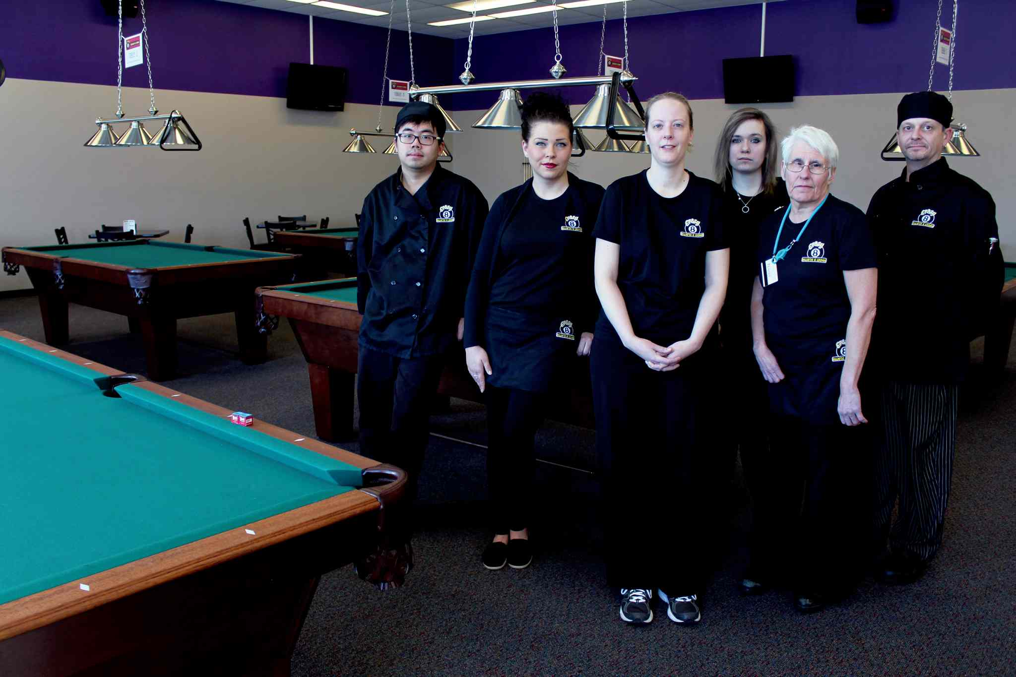 (From left) Star Wang, cook; Jennifer Merko, server; Alana Armstrong, owner; Victoria Newton, server; Penny Siemens, cashier; and Steve Beckman, kitchen manager at the newly opened Crazy 8 Billiards on Berry Street.