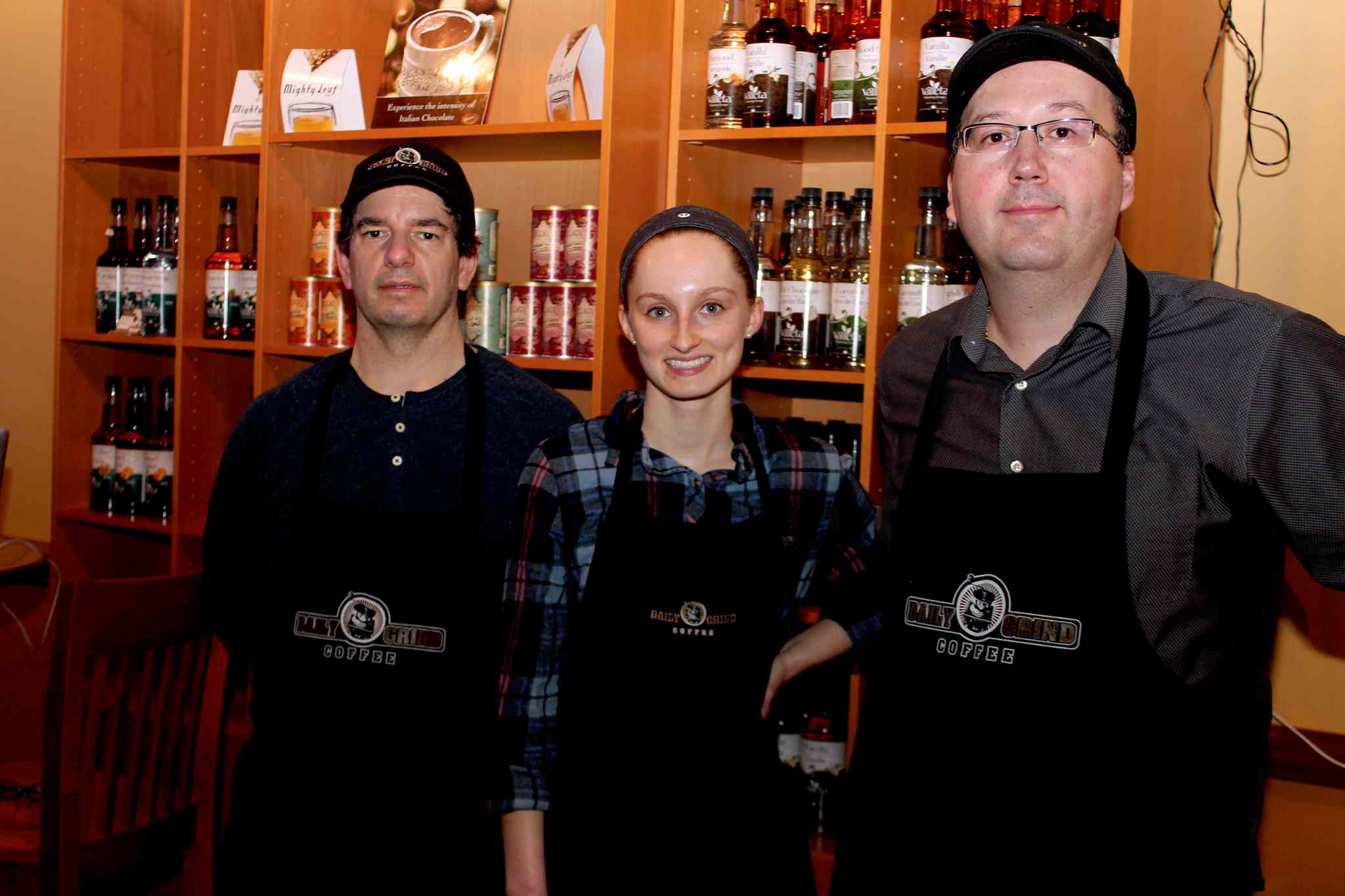 (From left) Tom Paquette, partner and manager; Louise Oborne, barista; and Massimo Iafolla, owner of Daily Grind Coffee.