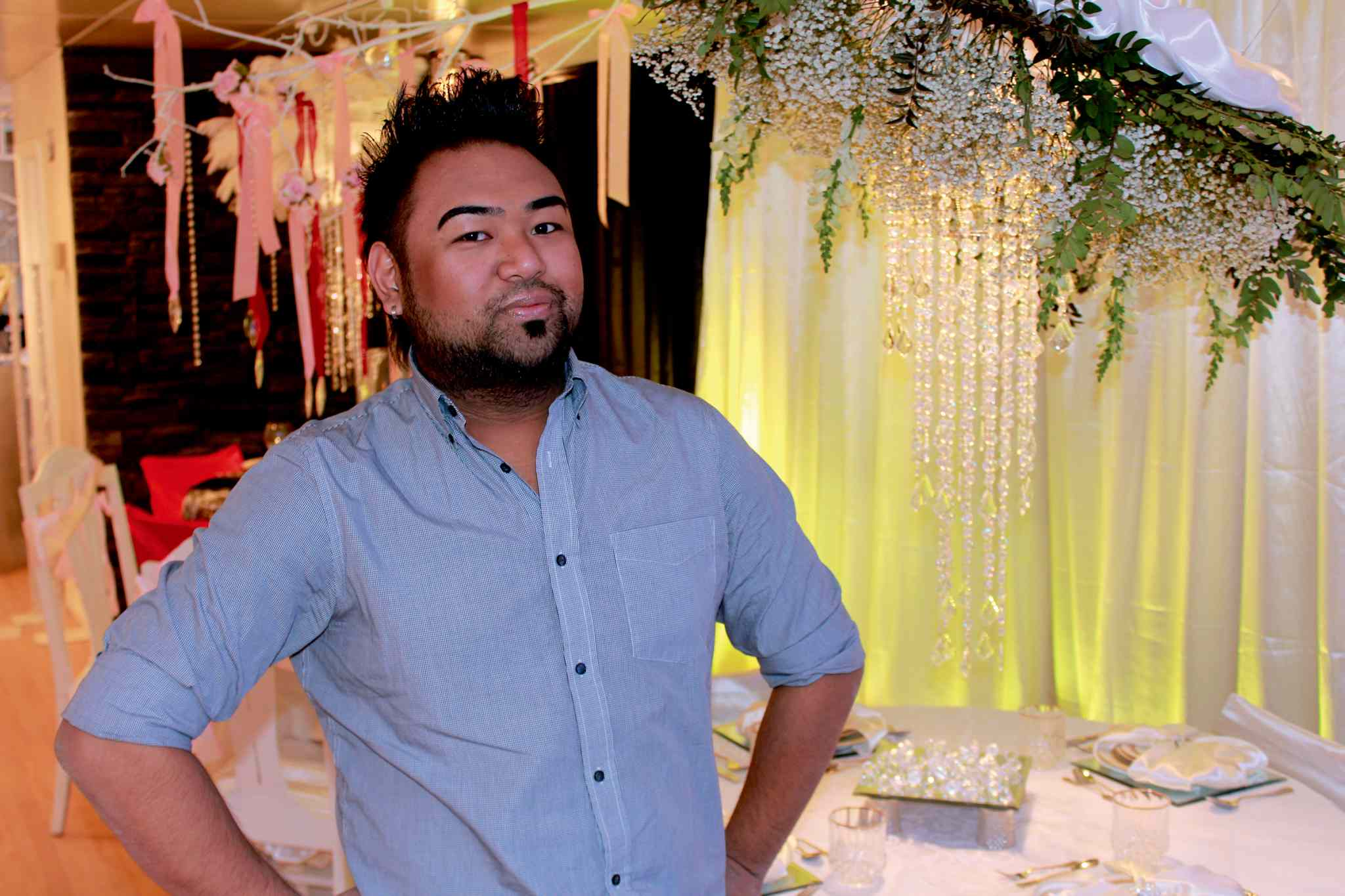 Justin Merluza, 24, opened his new business Just in Couture Nov. 1. He specializes in high-end weddings.