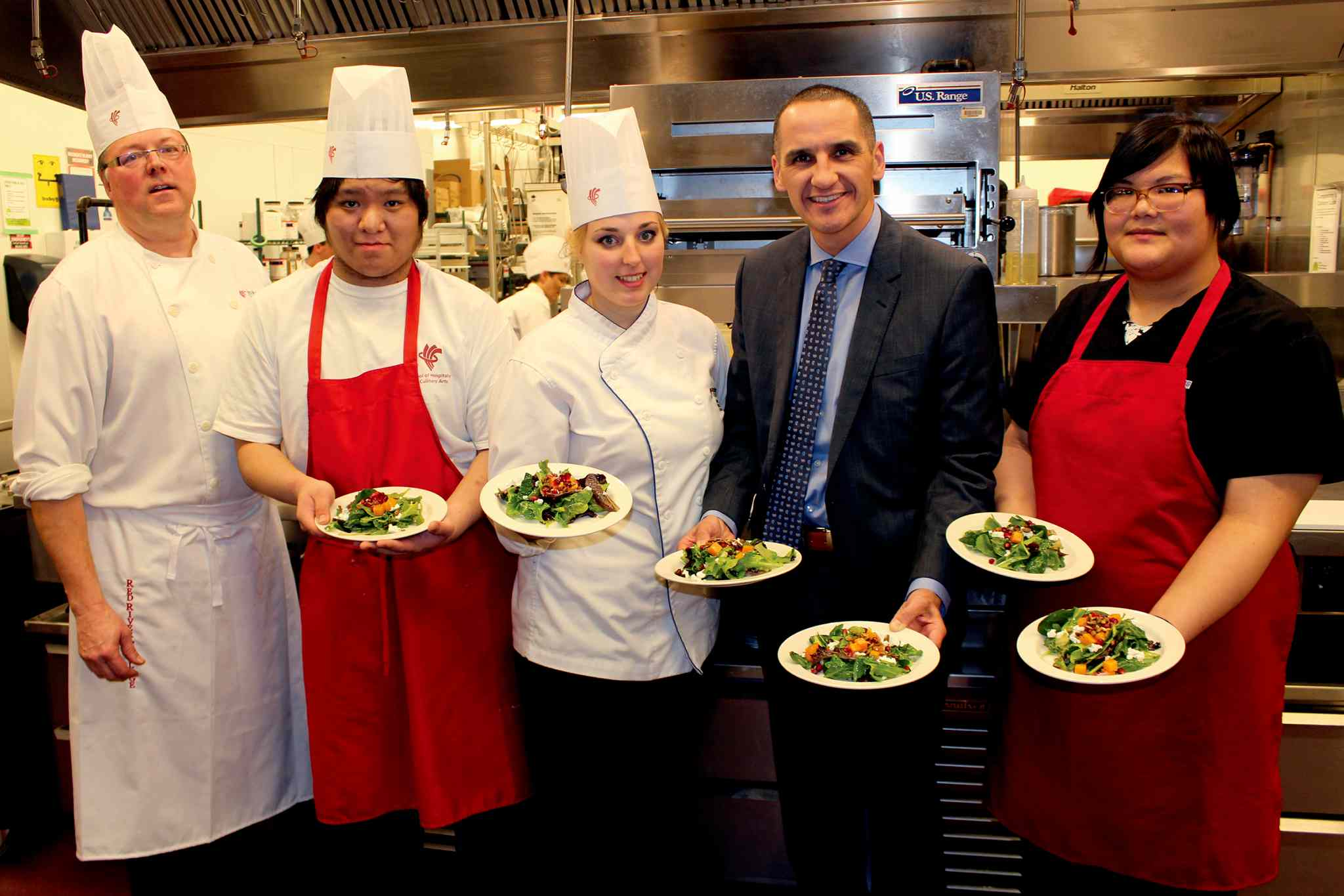 (From left) Chef Karl Oman, Culinary Arts instructor; Ben Nguyen, After School Leaders participant, Samantha Bencharski, Culinary Arts student, Kevin Chief, MLA for Point Douglas and Cheyla Ponace, After School Leaders participant.
