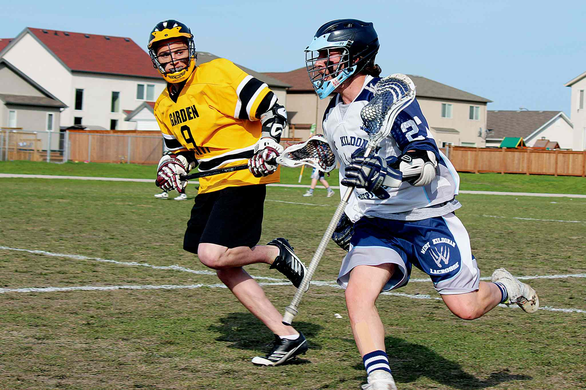 "West Kildonan Collegiate Wolverines lacrosse player Kelson Borisenko (right) in action against the Garden City Fighting Gophers on Thurs., May 22 at West Kildonan Collegiate. Dubbed the KC-JD Field Lacrosse Classic, the annual game is played in honour of late Winnipeg lacrosse players Kelly Clay and Justin ""JD"" Lysack."