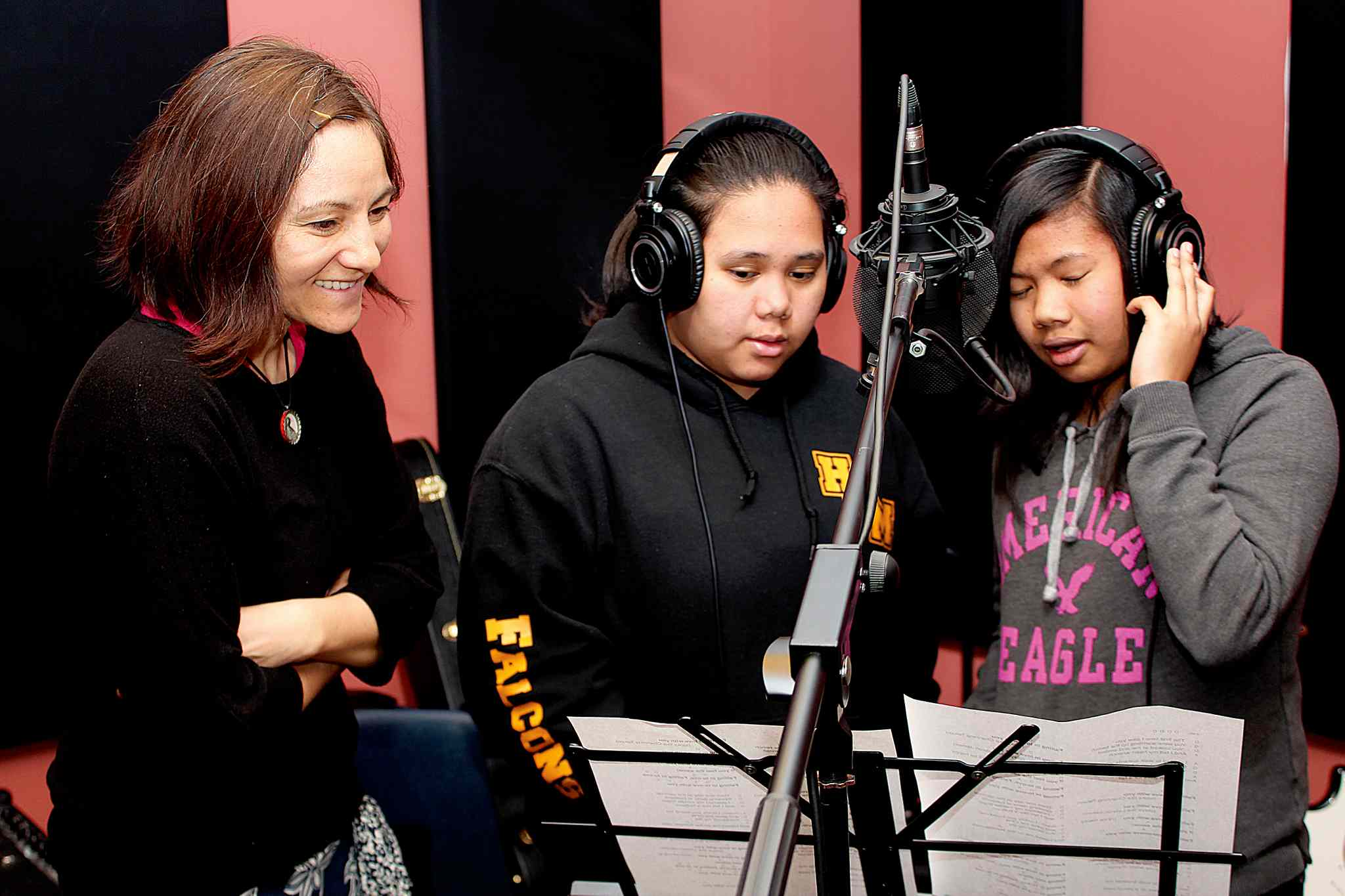 Hugh John MacDonald students Andrea Soquiat (centre) and Jerrileen Cuevas (right) are joined by Keri Latimer in the recording studio at the Broadway Neighbourhood Centre as part of the Winnipeg Folk Festival's Musical Mentors program.