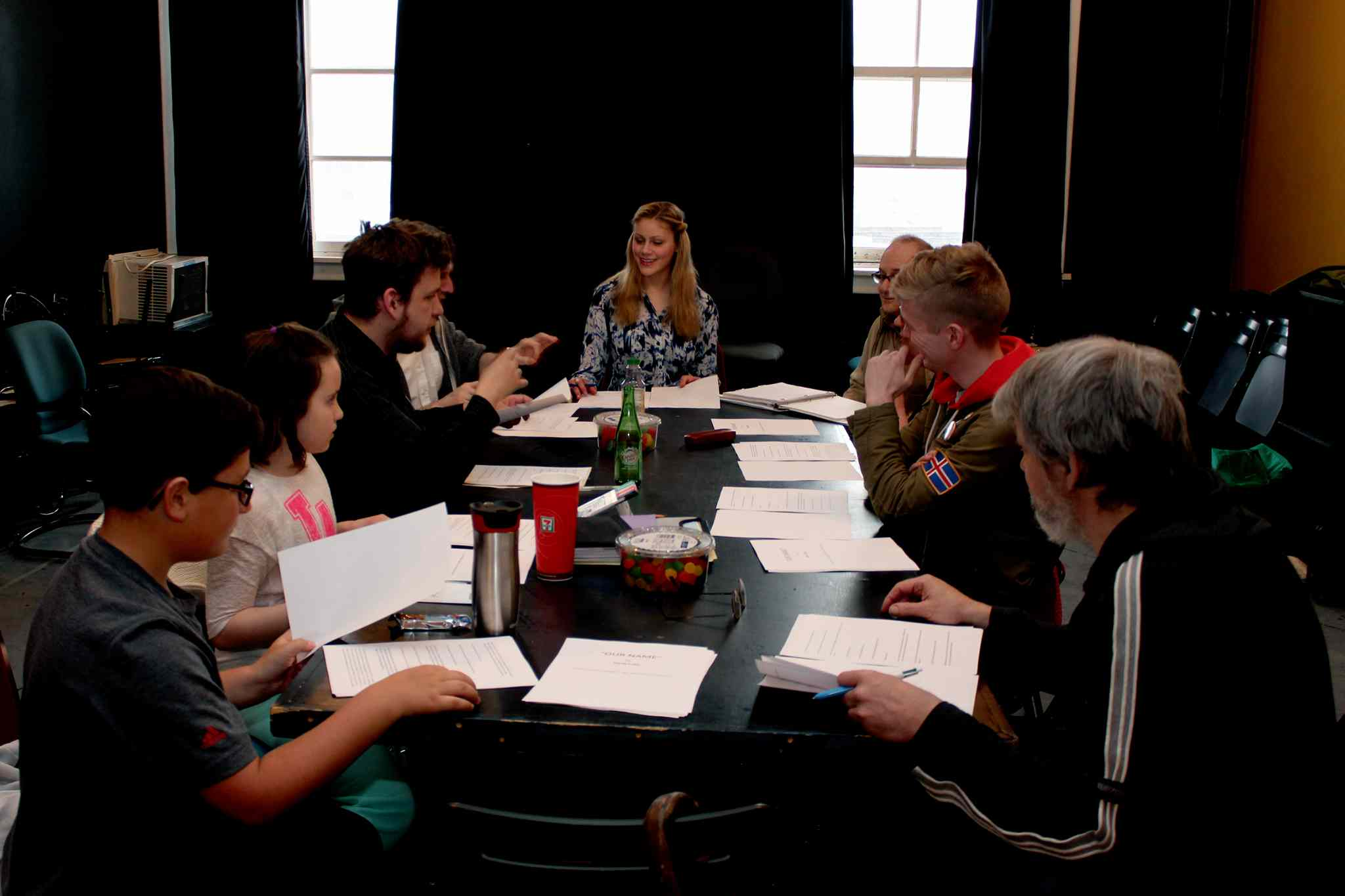 Luby (centre) does her first read through with the cast of her short play Our Name.