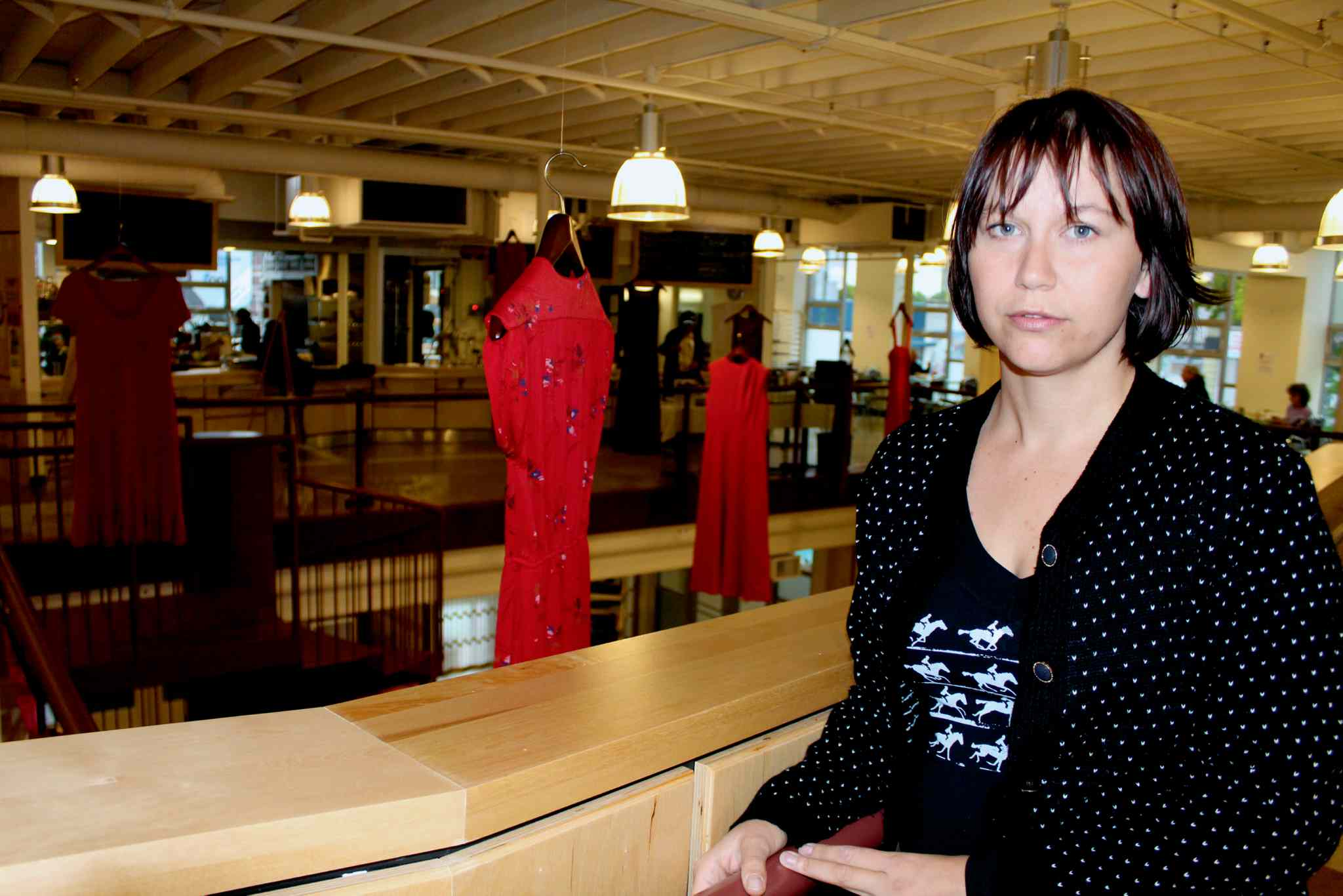 Artist Jaime Black with her visual art installation The REDress Project, created in response to the more than 600 reported cases of missing and murdered Aboriginal women across Canada. The installation is currently on display at Neechi Commons on Main Street.
