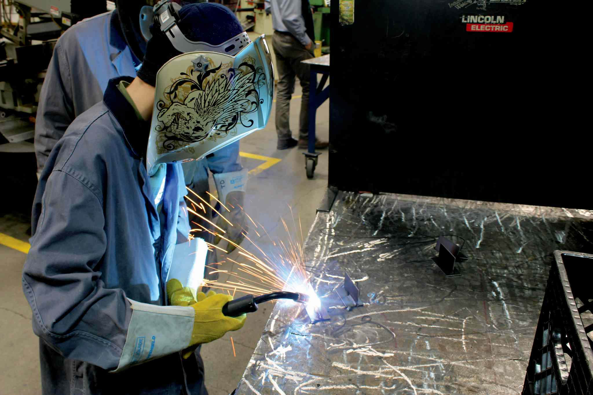 Sparks fly as Liam Drummond, a Grade 8 student at Linden Meadows School, works on a project in Winnipeg Technical College's welding classroom during a day of hands-on experience for students in the Pembina Trails school division.