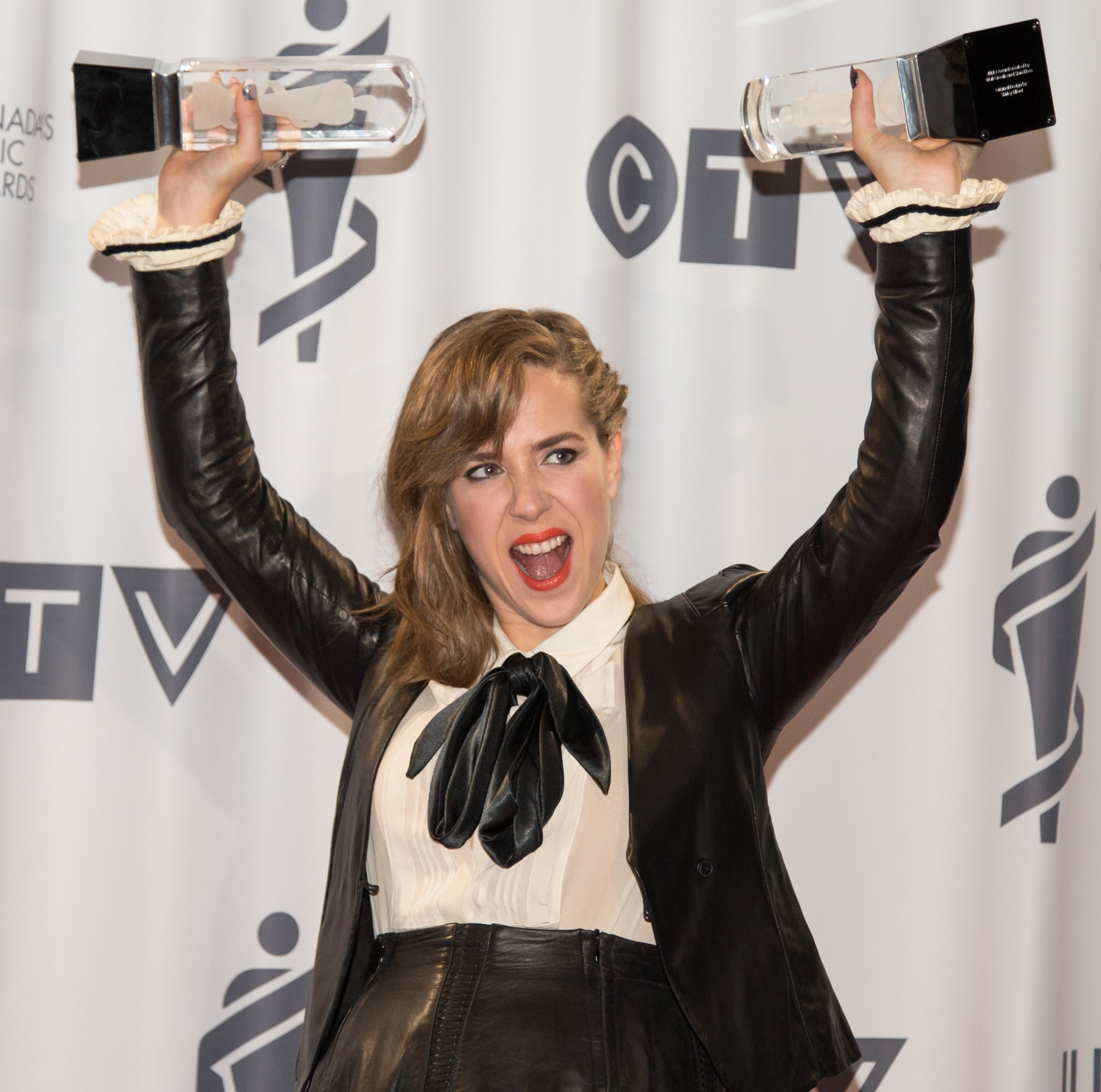 Serena Ryder with her two JUNOs, Songwriter of the Year and Artist of the Year, at the 2014 Juno Awards.