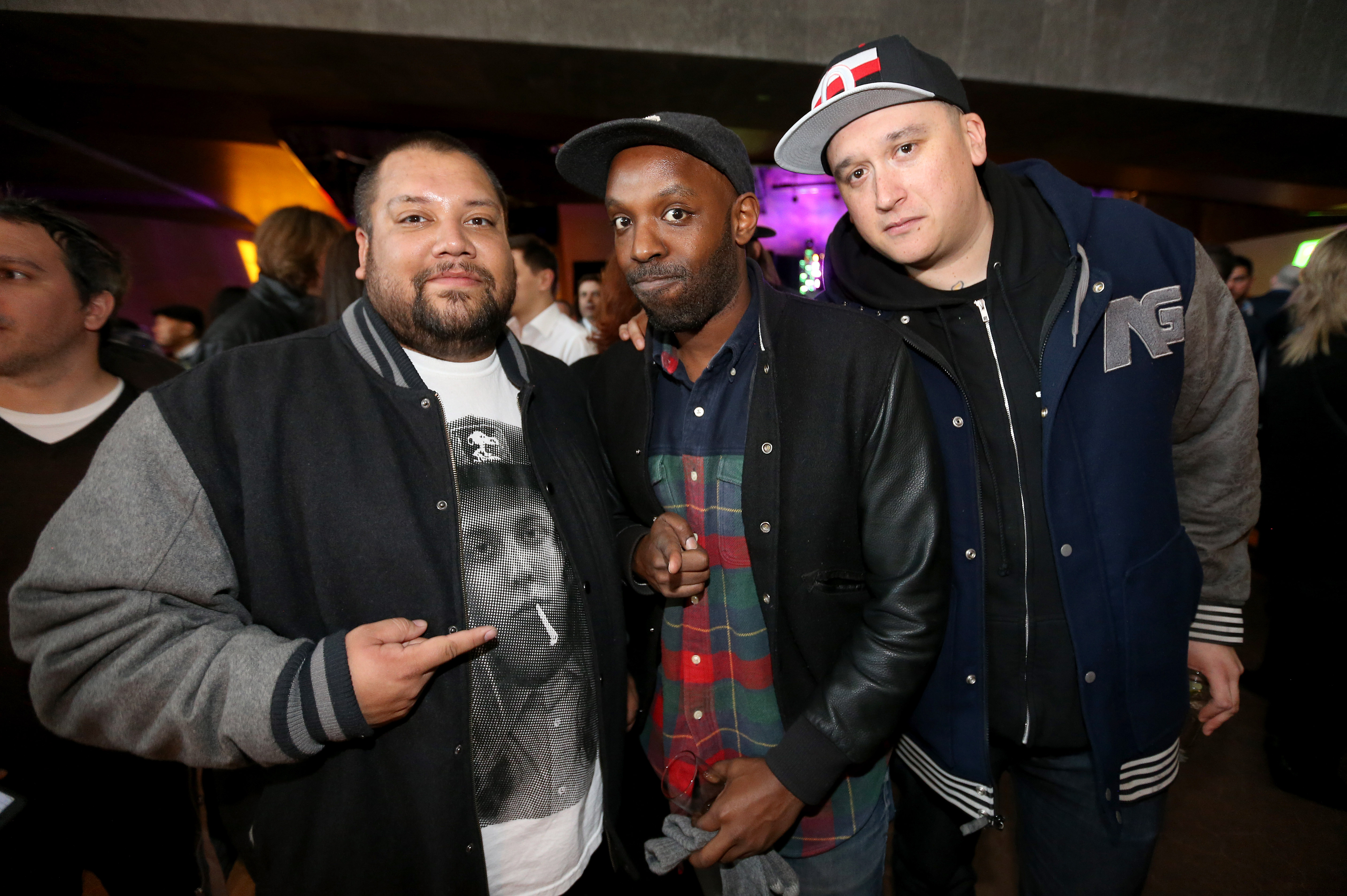 Members of A Tribe Called Red, left and right, with Shad, middle, take part in Friday's Juno Reception inside the Canadian Museum for Human Rights. Both are nominated for Junos.