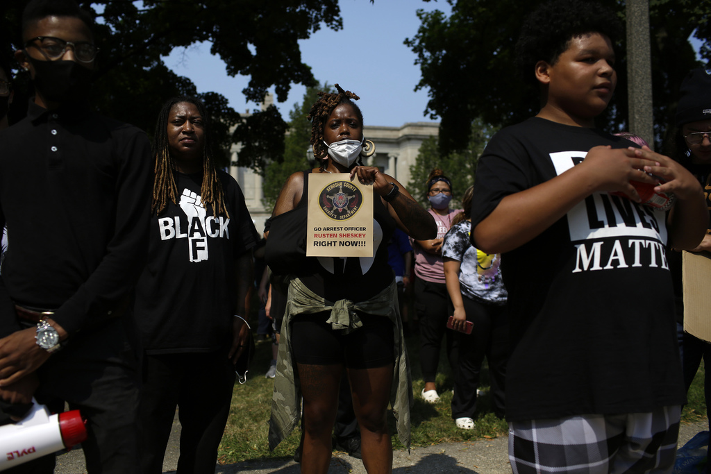 Demonstrators protest the shooting of Jacob Blake in Kenosha, Wis. A police officer shot the unarmed man in the back seven times. (Joshua Lott / The Washington Post files)
