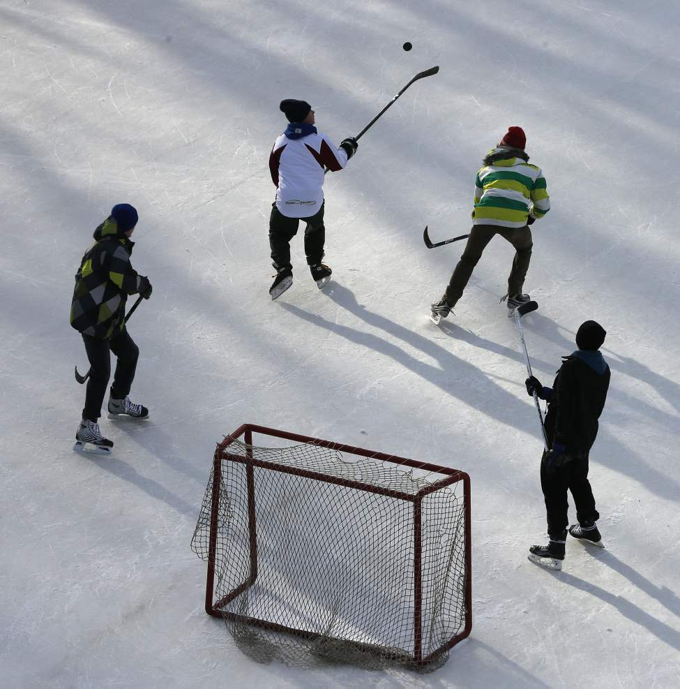 Warmer temps -13 and sunny  make the olympic sized hockey rink  at the Forks an ideal spot for  a game of shinny.  January 29, 2014  (KEN GIGLIOTTI / WINNIPEG FREE PRESS)