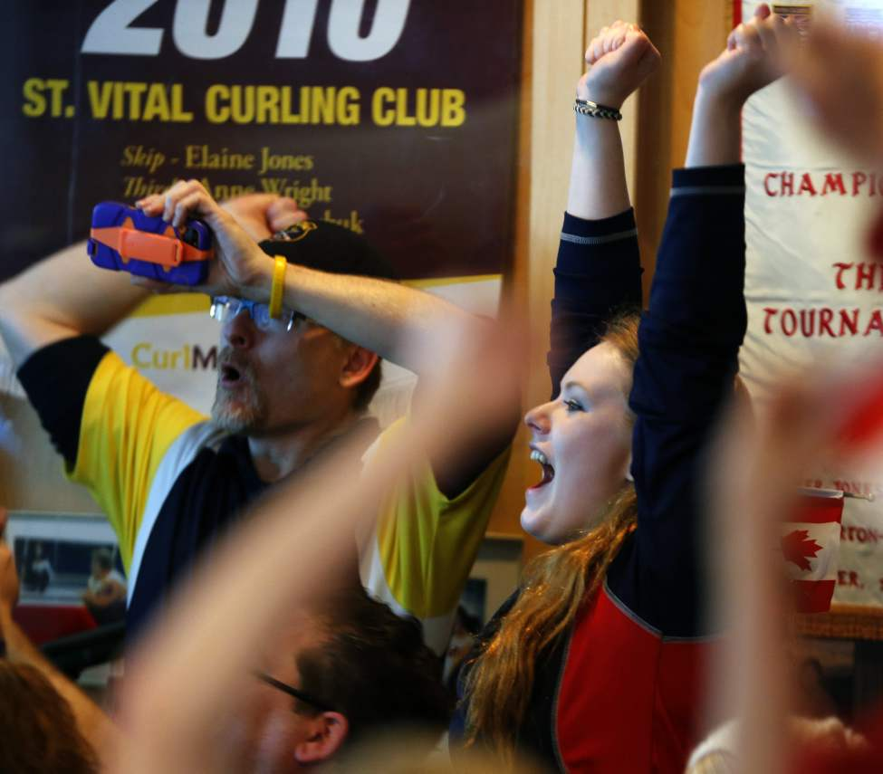 Hannah Beaudrey celebrates  with St.Vital Curling fans as Jennifer Jones wins Gold at the Sochi Olympics.  February 20, 2014 (KEN GIGLIOTTI / WINNIPEG FREE PRESS)