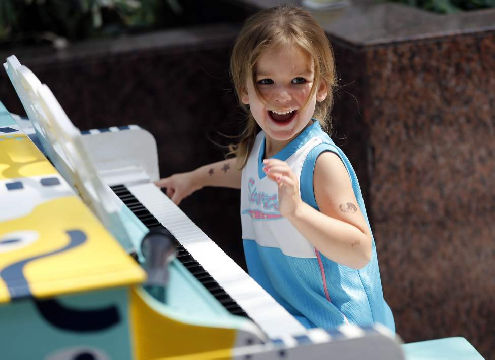 Jorja Geal, 3, plays piano at Portage Place during Juno Week. May 27, 2014 (KEN GIGLIOTTI / WINNIPEG FREE PRESS)