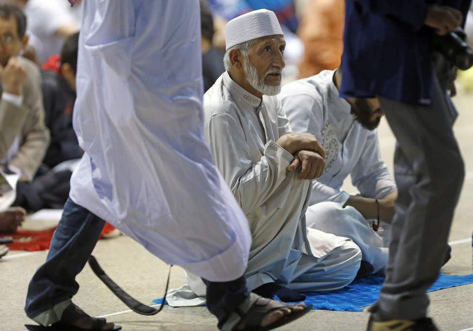Muslims by the thousands gathered to mark the end of Ramadan at the RBC Winnipeg Convention Centre. July 28, 2014 (KEN GIGLIOTTI / WINNIPEG FREE PRESS)