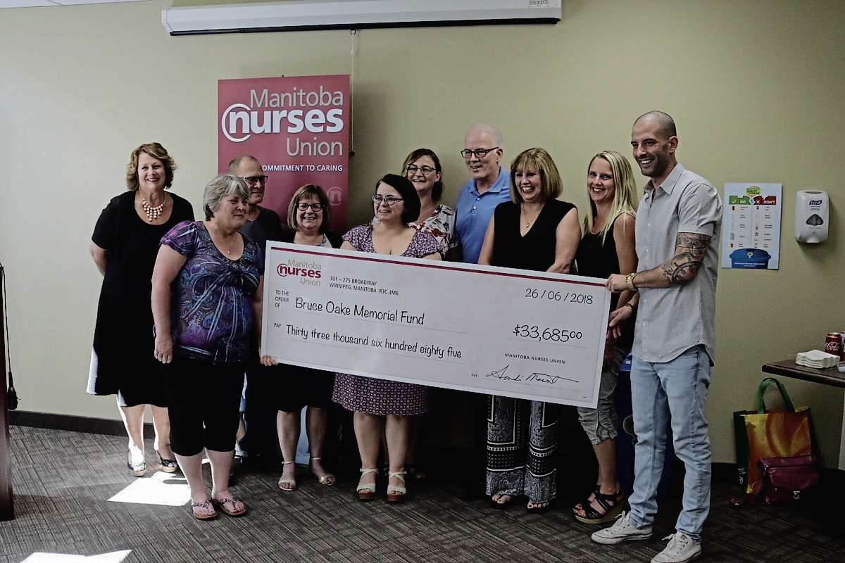 The Oake family with the Seven Oaks Nurses Union Local 72 at the cheque presentation on June 26. The chapter organized a fundraising drive which pulled in funds from all regions of the province, totalling $33,685.