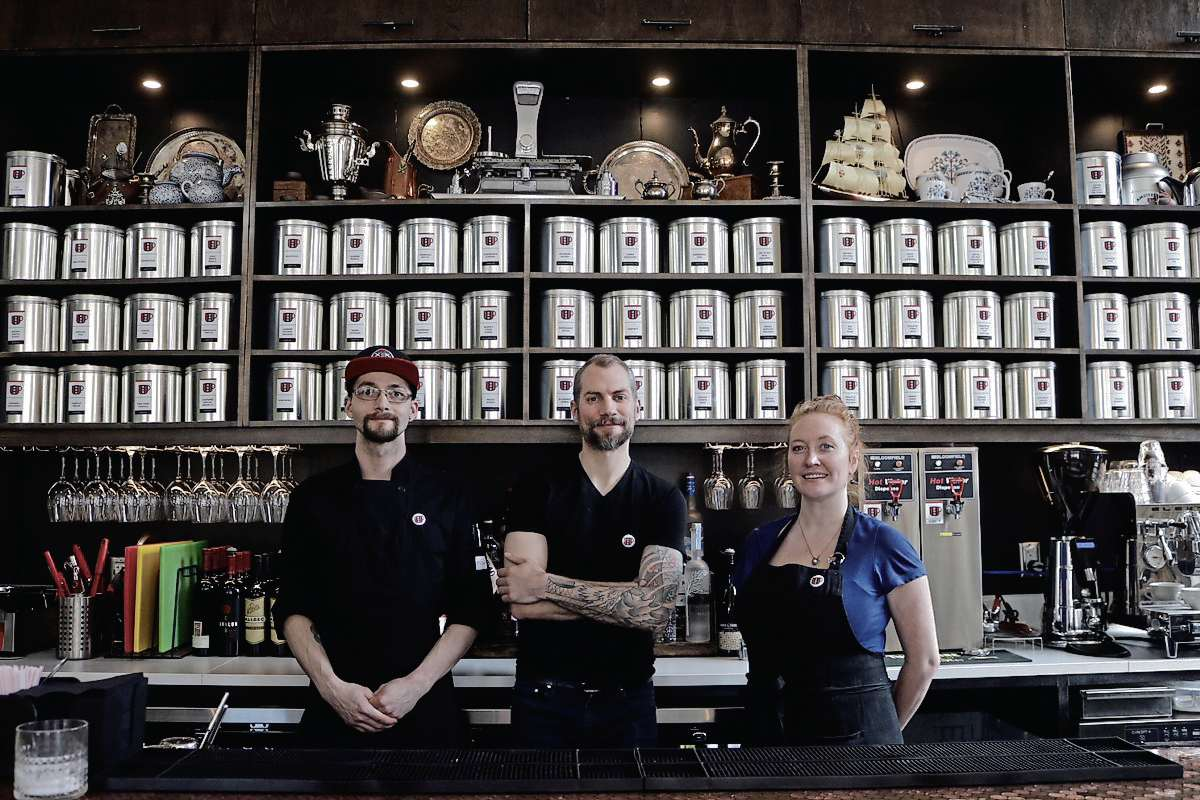 Mark Turner (middle), co-owner of Amsterdam Tea Room, with chef Alex McMullen and server Alissa Finch.