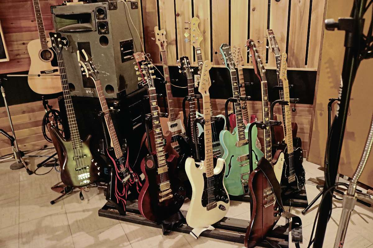 Milne keeps his guitar collection at the studio's recording room.