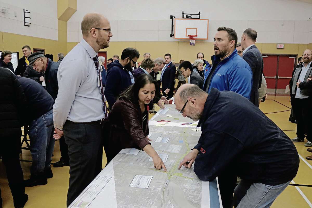 Public Works transportation and planning engineer Scott Suderman (left) and Old Kildonan ward coun. Devi Sharma (second left) pictured at the Chief Peguis Trail Extension information session on Nov. 7, 2017 at Red River Community Centre. Sharma was first elected as the Old Kildonan Ward councillor in 2010 and is seeking for a third term.