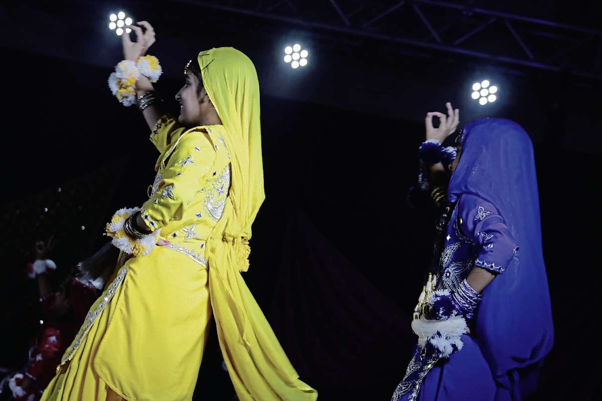 Girls presented traditional dances at the Punjab Pavilion from Aug. 5 to 11. (Photo by Ligia Braidotti)