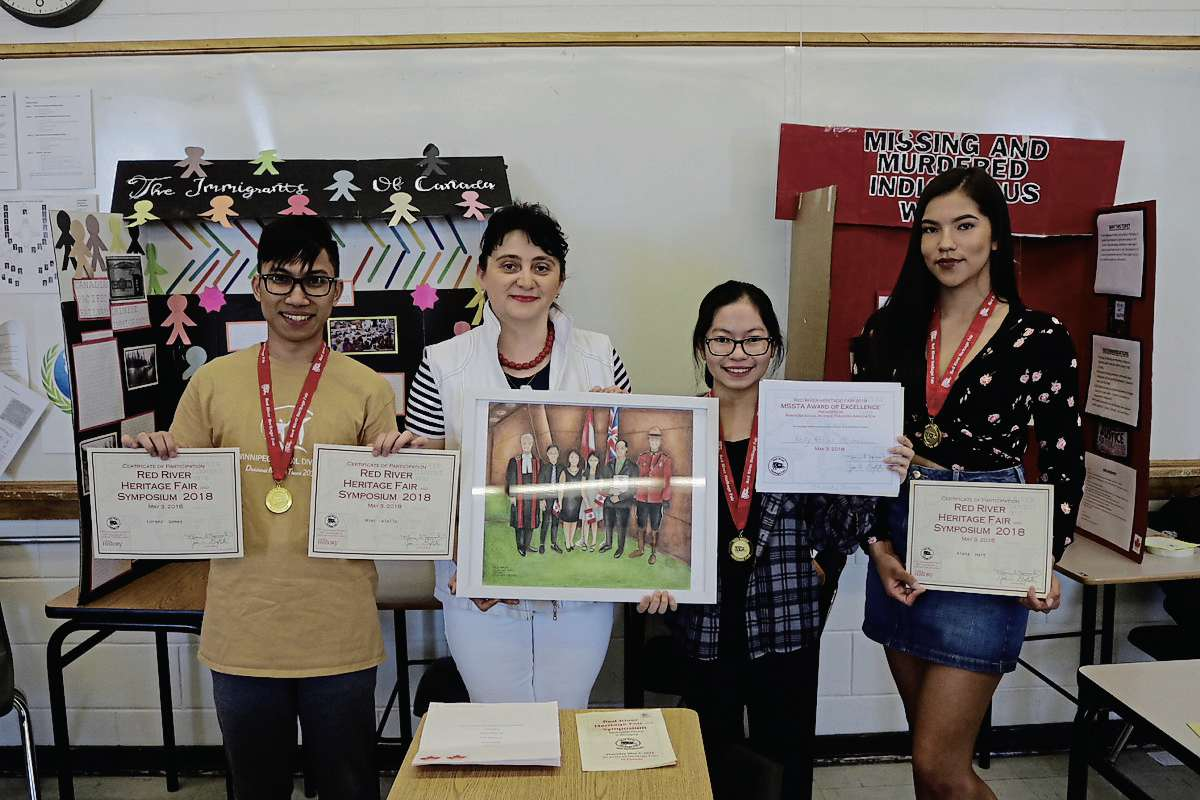 From left to right: Lorenz Gomez, Orysya Petryshyn, Kelly Abalus and Aiyana Hart holding the 2018 Red River Heritage Fair certificates and award. Missing is Mimi Aiello, who also participated in the fair.