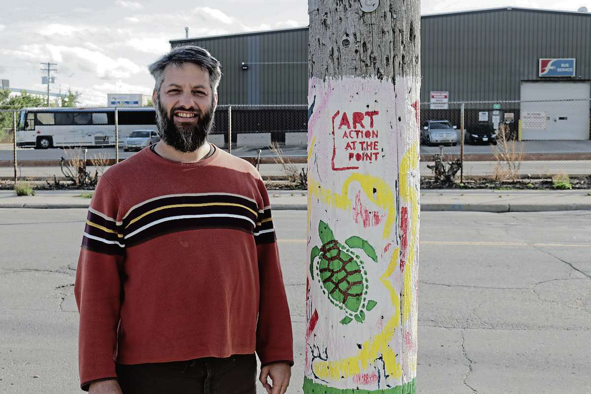 Edward Cloud is organizing the community to paint Manitoba Hydro poles spread out throughout North Point Dougla