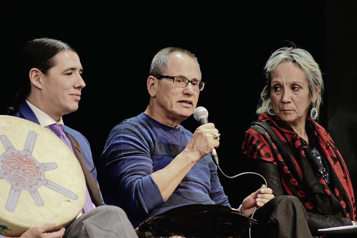 Damon Johnston (middle), president of the Winnipeg Aboriginal Council, speaks to Sisler High School students at their Indigenous relations panel discussion on March 13.