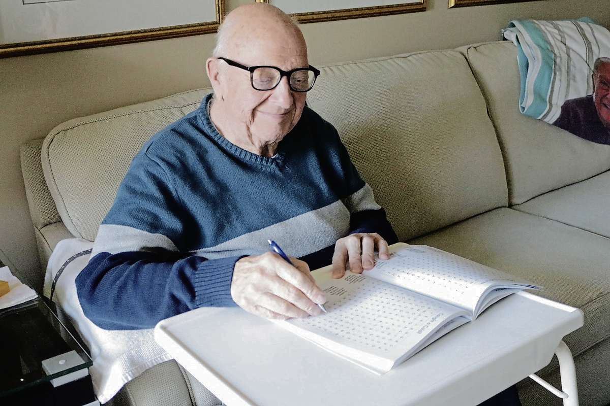 George Beckta is pictured doing word search puzzles. He has been living with vascular dementia for more than 10 years and has been keeping healthy with programs such as Minds in Motion.