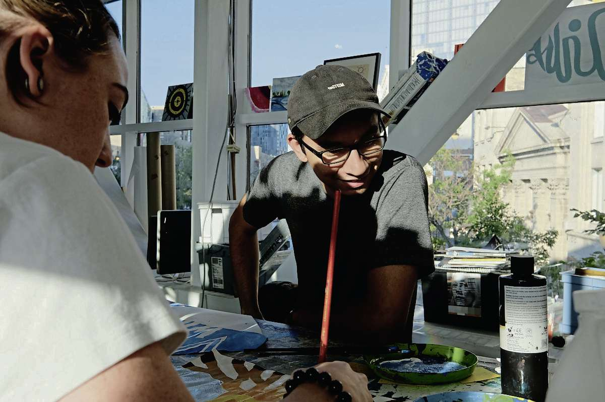 Jordan Stranger assists workshops participants and gives tips on painting and drawing strategies.