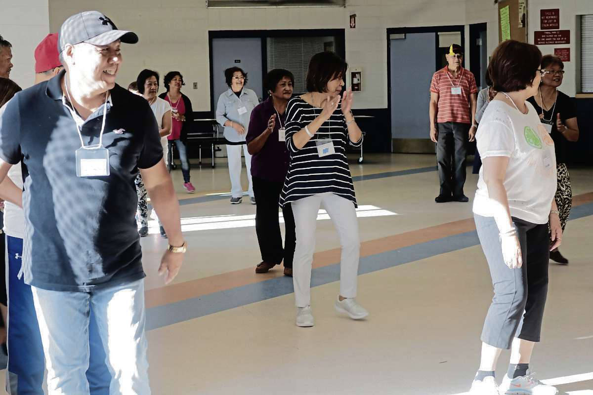 Tyndall Park seniors practice line dancing at the first Tyndall Park Community Centre Exercise 55+ Program.