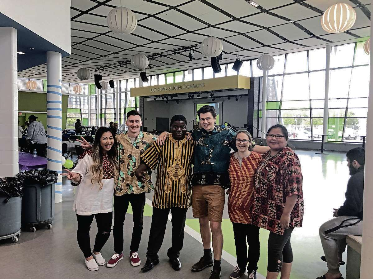 Othello Wesee (third from left) is the founder of the Liberian International Foundation for Equity and along with volunteers organized the World Refugee Day Celebration at Maples Collegiate held on June 20.