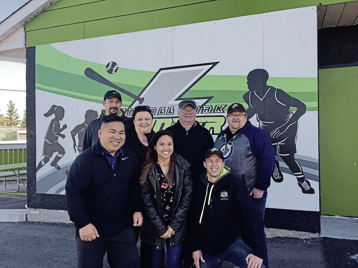 Coun. Mike Pagtakhan is pictured with Tyndall Park Community Centre's staff members in front of the new mural unveiled on Oct. 22 (SUPPLIED PHOTO)