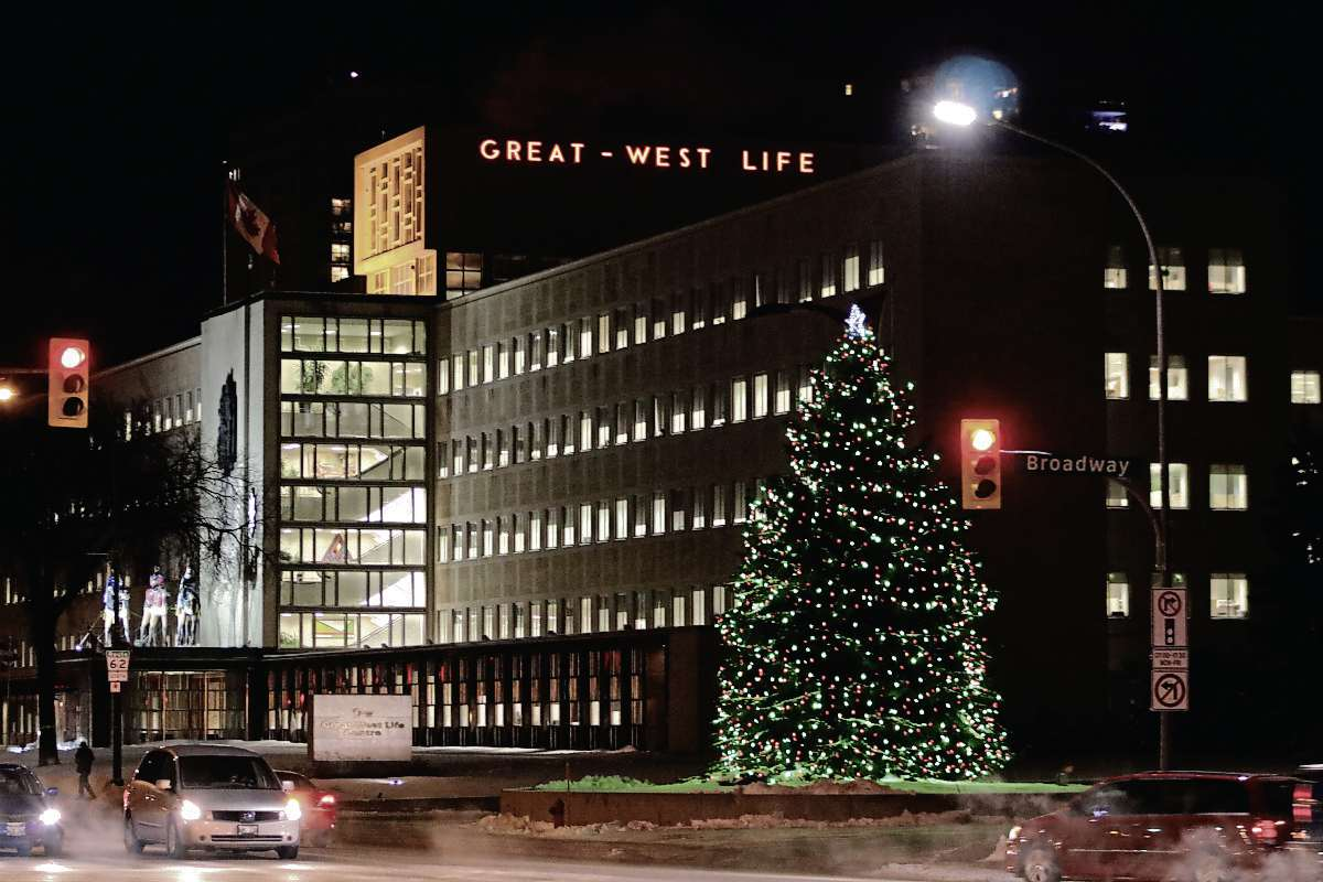 Whats open and closed over christmas in winnipeg winnipeg free press don kubaras blue spruce tree serves as a christmas tree at great west life on broadway malvernweather Image collections