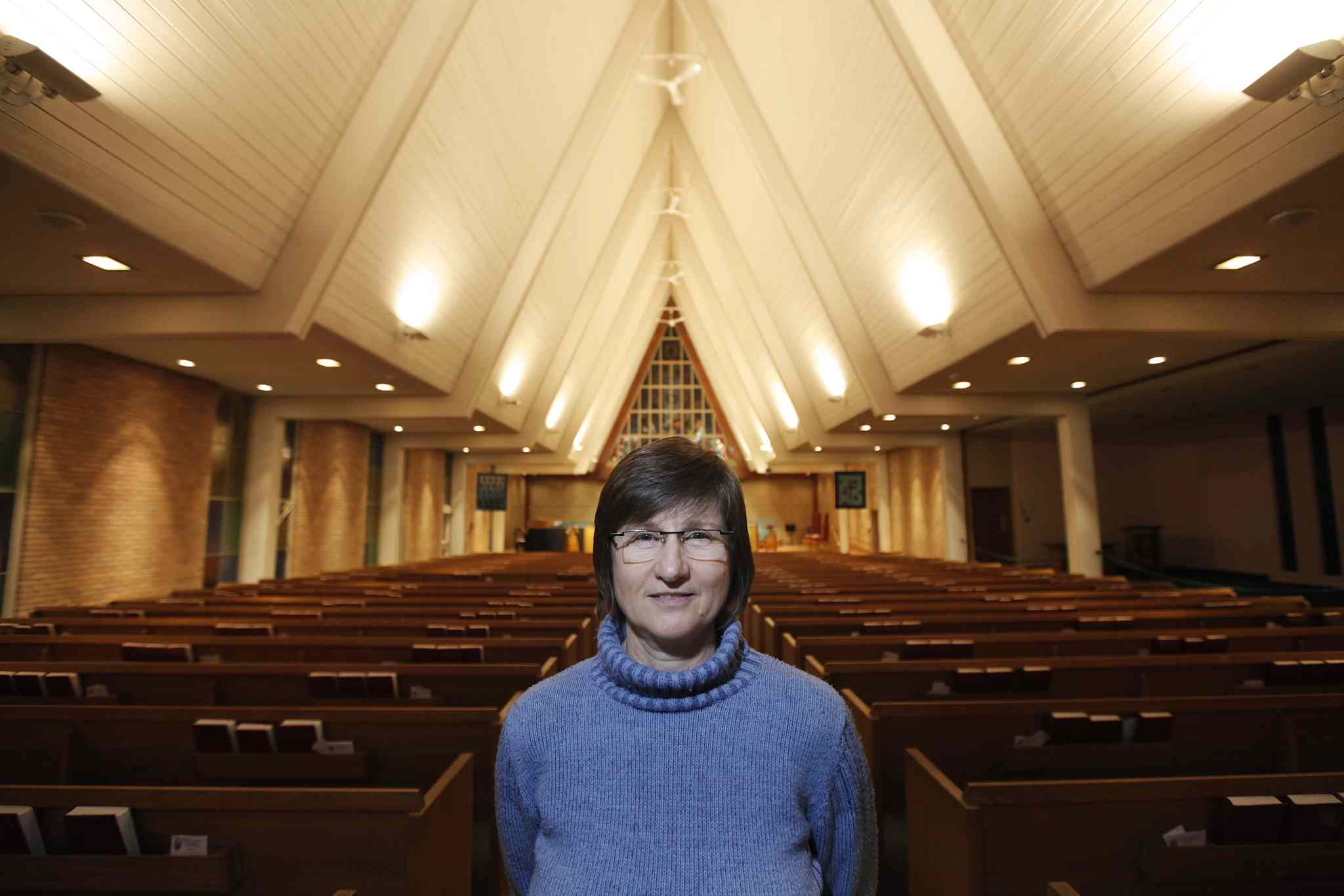Loraine MacKenzie Shepard, minister at Westworth United Church, and her congregation are helping Syrian refugee families to enter Canada. MacKenzie Shepard is photographed in her church Sunday.
