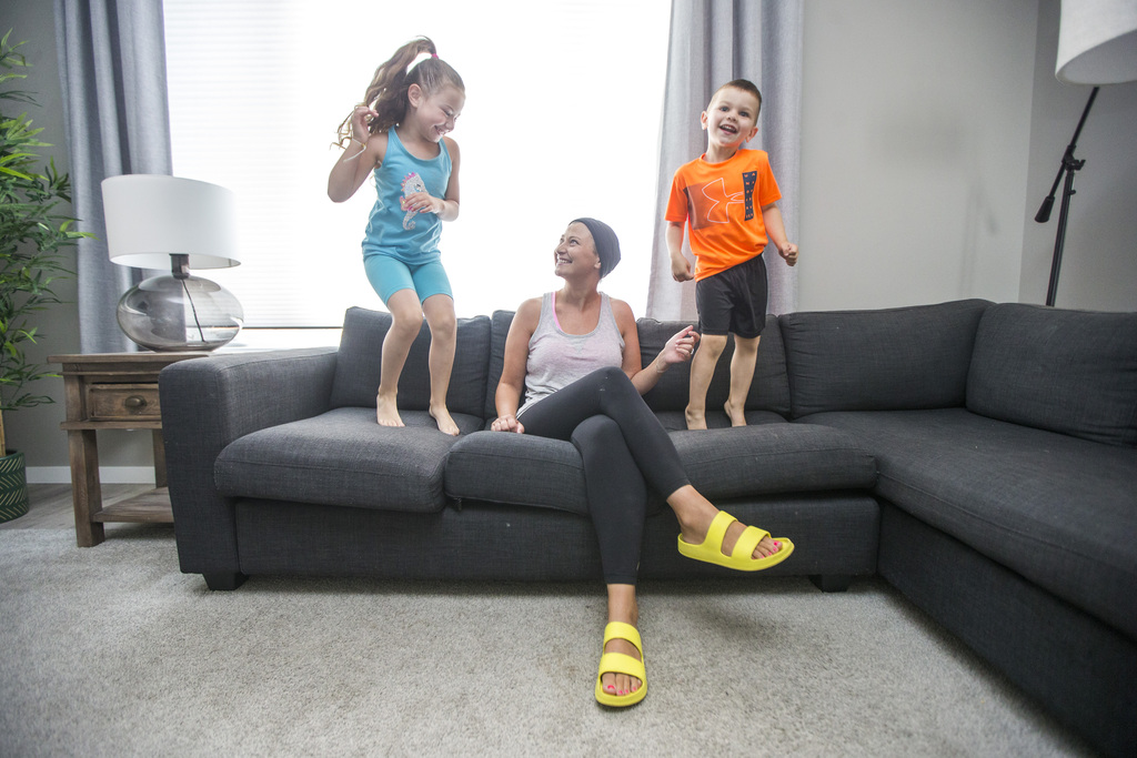 Lori Pierce enjoys putting the kids to bed and having them jump up and down because she now has the energy to put them back to bed, she says. (Mikaela MacKenzie / Winnipeg Free Press)