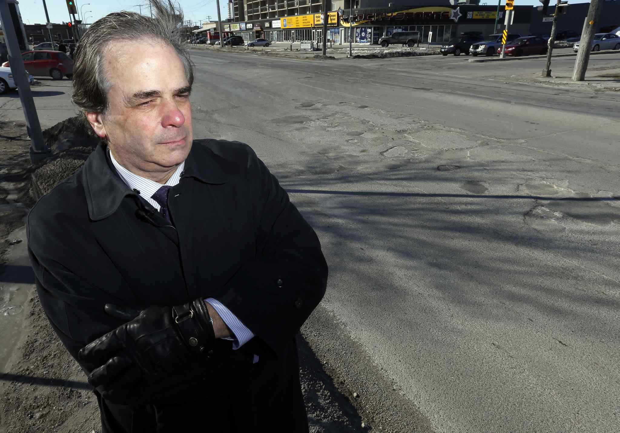 CAA President and CEO Mike Mager stands at the  corner of St. James Street and Ness Avenue as CAA launches its 3rd Annual Manitoba's Worst Roads Campaign.