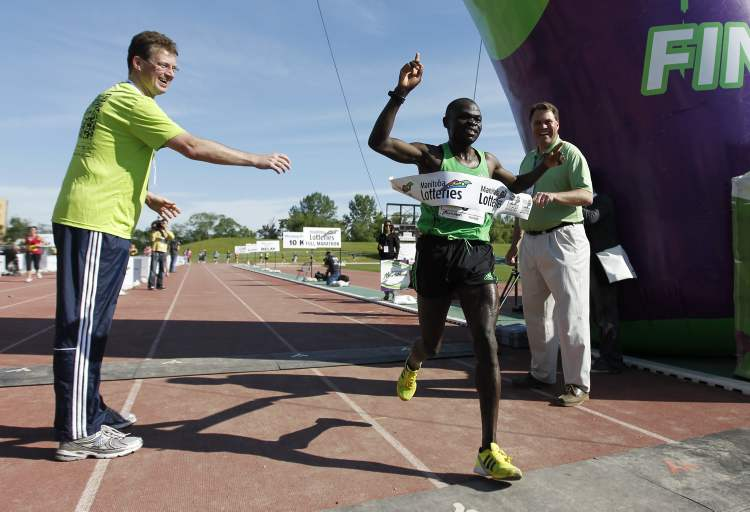 Thomas Omwenga from Kenya has won the 34th annual Manitoba Marathon with a time of 2:25:13. (TREVOR HAGAN / WINNIPEG FREE PRESS)