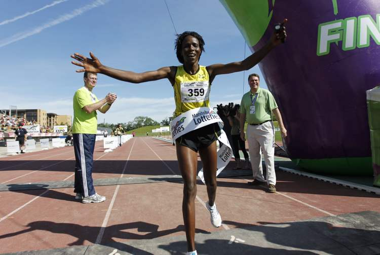 Anna Kibor was the first woman to cross the finish line in the 34th annual Manitoba full marathon with a time of 2:49:45. (TREVOR HAGAN / WINNIPEG FREE PRESS)