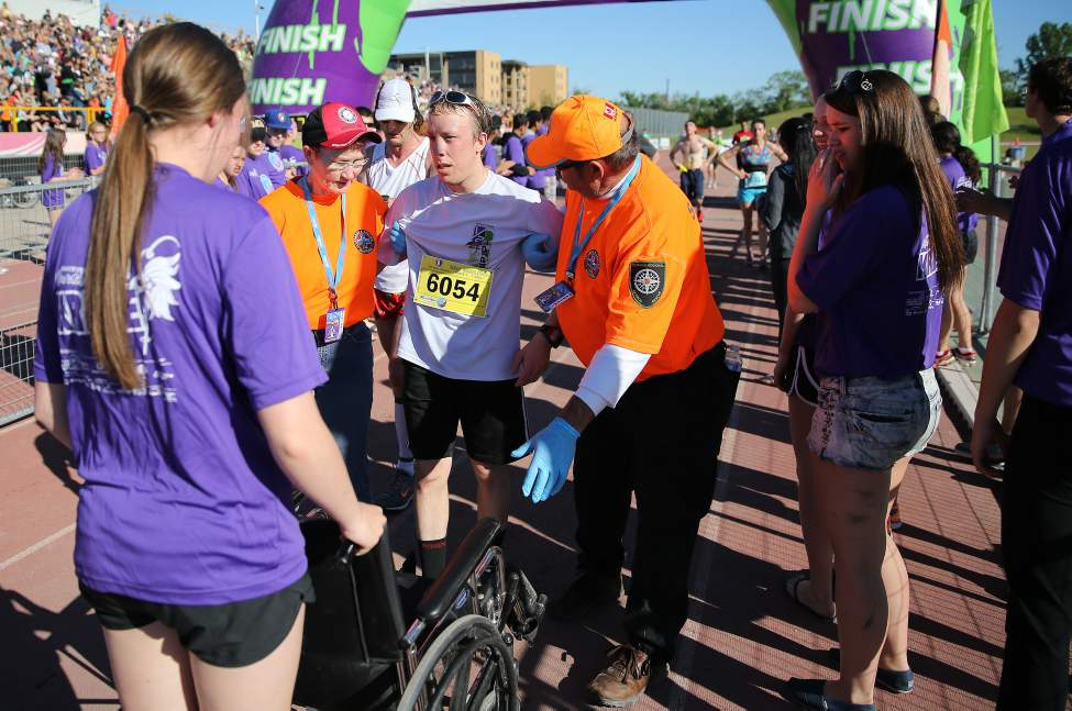 Half marathon participant getting help near the finish line. (TREVOR HAGAN/WINNIPEG FREE PRESS)