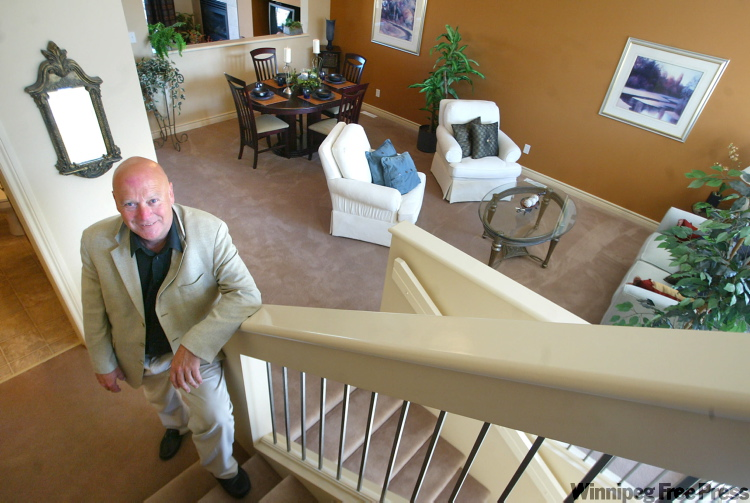Marcel Laurendeau poses in a show home in a 2007 file photo.